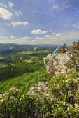 Hiker enjoying view of Germany Valley and Spruce Knob from North Fork Mountain Trail, Franklin, West Virginia, USA