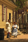 Costumed Interpreters outside their shops in the Historic Area, Colonial Williamsburg, Virginia, USA