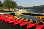 Boats and colorful kayaks at a marina on Deep Creek Lake, Thayerville, Maryland, USA
