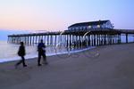 People strolling on the beach at sunrise, Kitty Hawk, North Carolina, USA
