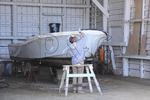 Man works on boat in Boatyard at Frisco, North Carolina, USA