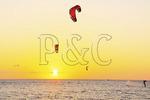 Kiteboarding at sunset on Pimlico Sound near Canadian Hole, Cape Hatteras National Seashore, Outer Banks, Buxton, North Carolina, USA