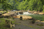 A bench for enjoying a view of the falls at Valley Falls State Park, Tygart Valley River, Grafton, West Virginia, USA