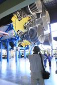 Tourist photographing Saturn V Engine, U.S. Space & Rocket Center, Huntsville, Alabama, USA