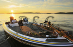 Fishing boat on lake at sunset, Lake Guntersville Resort State Park, Guntersville, Alabama, USA