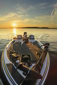 Fishing boat on lake at sunset, Lake Guntersville Resort State Park, Guntersville, Alabama, USA