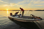 Fishermen on lake at sunset, Lake Guntersville Resort State Park, Guntersville, Alabama, USA