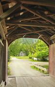 Covered bridge and church near West Arlington, Vermont, USA
