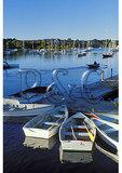 Man rowing in harbor at sunrise, Woods Hole, Cape Cod, Massachusetts