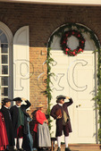 Men and Women with Christmas Decorations in Front of Courthouse, Colonial Williamsburg, Virginia, USA