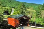 Covered bridge and church near West Arlington, Vermont