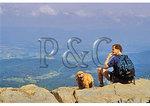 Hiker and dog on Little Stony Man, Appalachian Trail, Shenandoah National Park, Virginia