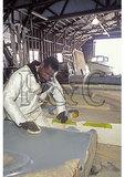 Waxing fiberglass mold, Tiffany Yachts, Burgess, Virginia