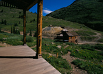 Front porch of abandoned house overlooks the Columbus Mill at Animas Forks