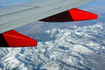 Aerial view of Colorado's snow-capped Rocky Mountains, as seen from under the wing of a commercial jetliner flying at 38,000 feet MSL.