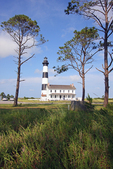 Landscape view of the Bodie Island Lighthouse as it now stands on the northern end of the Cape Hatteras National Seashore on North Carolina's Outer Banks.