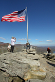 An American flag stands watch over the surface of the granite promontory of Chimney Rock in the recently-christened Chimney Rock State Park.  Until 2006 when it was deeded to the State of North Carolina as state park land, Chimney Rock was privately owned and operated for almost 100 years.