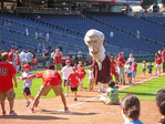 Presidential mascots corral kids of all ages to run the bases in a Sunday afternoon post-game tradition at Nationals Park in Washington, DC.