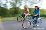 Young couple riding Cruiser bikes on Bike Path