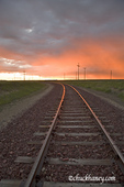 Railroad tracks lit by spectacular sunrise near Lewistown Montana