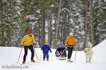 Family Cross Country Skiing on the Stillwater Lodge nordic trails in the Stillwater State Forest near Whitefish Montana, model released