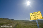 Dirt road with warning signage near Hot Springs Montana