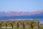 Sunset clouds over stack of hay bales near Lewistown Montana