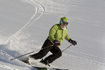Skier on fresh corduroy on  a sunny day of skiing at Whitefish Mountain Resort in Montana model released