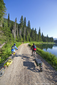 Mountain bike touring on the Great Divide Route in the Flathead National Forest at Red Meadow Lake in Montana model released