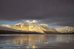 Sun breaks through the clouds at Lake McDonald on a winter evening in Glacier National Park in Montana