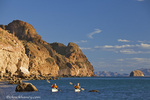 Sea kayakers on the Gulf of California at Isla Danzante near Loreto Mexico model released