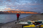 Sea kayaker looking forward to the days paddle on the Gulf of California at Isla Carmen near Loreto Mexico model released