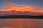 Lenticular clouds reflect into St Mary Lake at sunset in Glacier National Park, Montana, USA