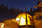 Tent glows at dusk during winter camping near West Glacier, Montana, USA model released