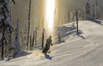 Jen Dolan skis through a sundog on corduroy groomed runs at Whitefish Mountain Resort in Montana model released
