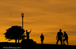 A game of stickball at sunset in Alamo Square Park in San Francisco, California, USA