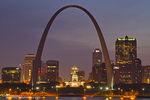 The Gateway Arch and St Louis skyline reflect into the Mississippi River at dusk in St Louis, Missouri, USA