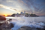 Waves crash on rocky shoreline at Nubble aka Cape Neddick Lighthouse in York, Maine, USA