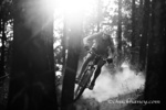 Courtney Feldt mountain bikes on dusty singletrack of the Whitefish Trail near Whitefish, Montana, USA MR