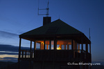 Werner Peak Lookout Tower glows under lantern light at night in the Stillwater State Forest, Montana, USA  MR