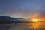 Morning sunrise burns through the fog on the Missouri River at the Upper Missouri River Breaks National Monument, Montana, USA