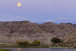 Full moon rises over badlands at the Upper Missouri River Breaks National Monument, Montana, USA
