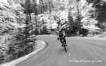 Road biking with speed on East Lakeshore Drive in autumn in Whitefish, Montana, USA MR