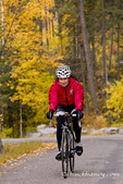 Road biking on East Lakeshore Drive in autumn in Whitefish, Montana, USA MR