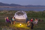 Family sits around the tent while camping at Ennis Lake near Ennis, Montana, USA model released