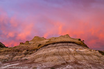 Fiery sunrise clouds over badlands at dawn in Theodore Roosevelt National Park, North Dakota, USA