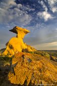 Sculpted badlands formation in short grass prairie in Garfield County, Montana, USA