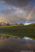 Double rainbow during dramatic late evening light on Bowman Lake in Glacier National Park, Montana, USA