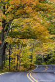 Autumn canopy of color along Highway 41 leading into Copper Harbor, Michigan, USA