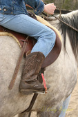 Young rider with cowboy boots